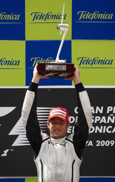 Circuit de Catalunya, Barcelona, Spain 10th May 2009 Jenson Button, Brawn GP BGP001 Mercedes, 1st position, celebrates victory on the podium. Portrait. Podium.  World Copyright: Steve Etherington/LAT Photographic ref: Digital Image SNE13949
