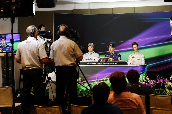 Marina Bay Circuit, Singapore. Saturday 21st September 2013.  Nico Rosberg, Mercedes AMG, Sebastian Vettel, Red Bull Racing, and Romain Grosjean, Lotus F1, in the press conference after qualifying.  World Copyright: Charles Coates/LAT Photographic. ref: Digital Image _N7T5280