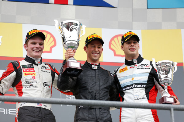 2013 GP3 Series. Round 6.  Spa - Francorchamps, Spa, Belgium. 25th August. Sunday Race. Alexander Sims (GBR, Carlin) celebrates his victory on the podium with Conor Daly (USA, ART Grand Prix) and Facu Regalia (ARG, ART Grand Prix). World Copyright: Alastair Staley/GP3 Media Service. ref: Digital Image _R6T8325.jpg