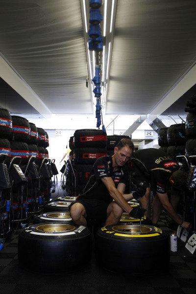 Hungaroring, Budapest, Hungary26th July 2012Lotus GP mechanics prepare a batch of  tyres.World Copyright:Andrew Ferraro/LAT Photographicref: Digital Image AF5D9145