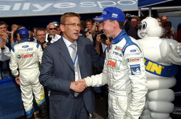 Rally winner Markko Martin (EST) is congratulated by the Estonian Prime Minister Juhan Parts.