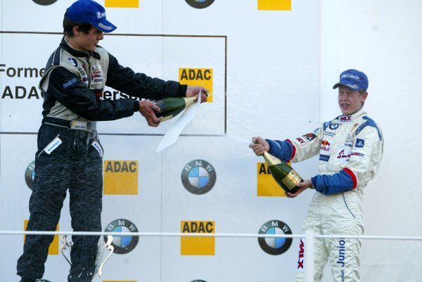 Champagne for race winner Michael Vorba (CZE), American Bull Racing, (left), and Sebastian Vettel (GER), Eifelland Racing (3rd, right). 