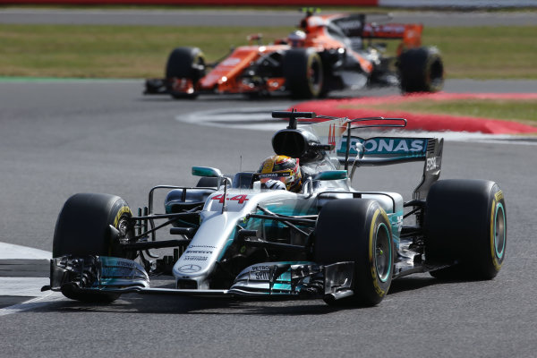 Silverstone, Northamptonshire, UK.  Friday 14 July 2017. Lewis Hamilton, Mercedes F1 W08 EQ Power+, leads Stoffel Vandoorne, McLaren MCL32 Honda.  World Copyright: Charles Coates/LAT Images  ref: Digital Image AN7T4290