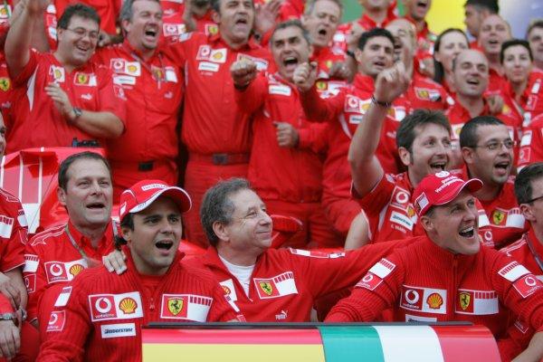 2006 Brazilian Grand Prix - Sunday Race Interlagos, Sao Paulo, Brazil. 19th - 22nd October 2006. The Ferrari team say goodbye and thank you to Michael Schumacher after the 7 times World Champion retires, portrait. World Copyright: Lorenzo Bellanca/LAT Photographic ref: Digital Image MU4Z4410