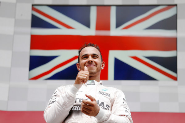 Circuit Gilles Villeneuve, Montreal, Canada. Sunday 7 June 2015. Lewis Hamilton, Mercedes AMG, 1st Position, on the podium. World Copyright: Steven Tee/LAT Photographic. ref: Digital Image _X0W6816