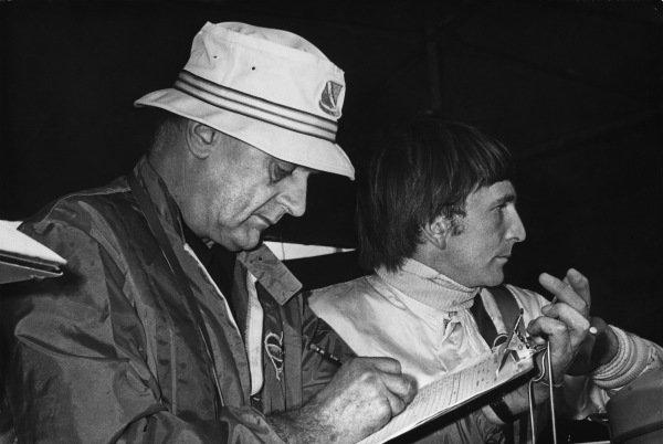 Le Mans, France. 12-13 June 1971.Derek Bell with Gulf Porsche team boss, John Wyer, portrait. World Copyright: LAT Photographic.Ref:  B/W Print.