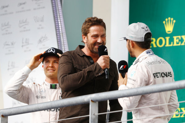 Circuit of the Americas, Austin Texas, USA. Sunday 23 October 2016. Gerard Butler interviews Lewis Hamilton, Mercedes AMG, 1st Position, on the podium. World Copyright: Steven Tee/LAT Photographic ref: Digital Image _O3I1856