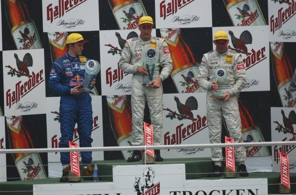 DTM Championship 2002, Round 10 - Hockenheimring, Germany, 6 October 2002 - Podium of the last race of the 2002 season. 1st: Bernd Schneider (Vodafone AMG-Mercedes); 2nd: Mattias Ekström (Team Abt); 3rd: Uwe Alzen (Warsteiner AMG-Mercedes).