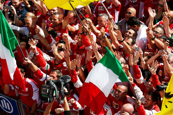 Hungaroring, Budapest, Hungary. Sunday 26 July 2015. The Ferrari team cheer for Sebastian Vettel, Ferrari, 1st Position, on the podium. World Copyright: Alastair Staley/LAT Photographic ref: Digital Image _79P0903