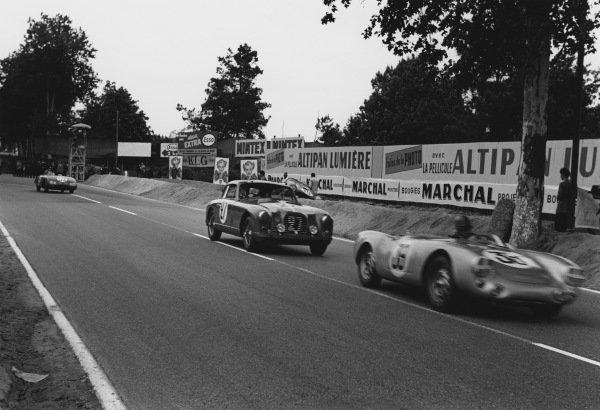 Le Mans, France. 12th - 13th June 1954.Johnny Claes/Pierre Stasse (Porsche 550/1500 RS), 12th position, leads Jean-Paul Colas/Nano da Silva Ramos (Aston Martin DB2/4), retired, action. World Copyright: LAT Photographic.Ref: 5343G - 19A.