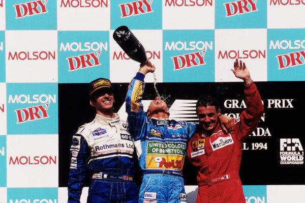 1994 Canadian Grand Prix.Montreal, Quebec, Canada.10-12 June 1994.Michael Schumacher (Benetton Ford) 1st position, Damon Hill (Williams Renault) 2nd position and Jean Alesi (Ferrari) 3rd position on the podium.Ref-94 CAN 04.World Copyright - LAT Photographic