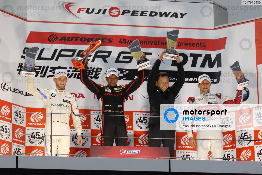 Super GT - DTM Dream Race. Narain Karthikeyan, Modulo Nakajima Racing, Honda NSX-GT GT500, 1st in race two, celebrates on the podium with Marco Wittmann, BMW Team RBM, BMW M4 DTM, 2nd, and Loic Duval, Audi Sport Team Phoenix, Audi RS5 Turbo DTM, 3rd. Satoru Nakajima accepts the trophy for the winning team
