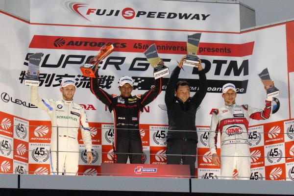 Super GT - DTM Dream Race. Narain Karthikeyan, Modulo Nakajima Racing, Honda NSX-GT GT500, 1st in race two, celebrates on the podium with Marco Wittmann, BMW Team RBM, BMW M4 DTM, 2nd, and Loic Duval, Audi Sport Team Phoenix, Audi RS5 Turbo DTM, 3rd. Satoru Nakajima accepts the trophy for the winning team
