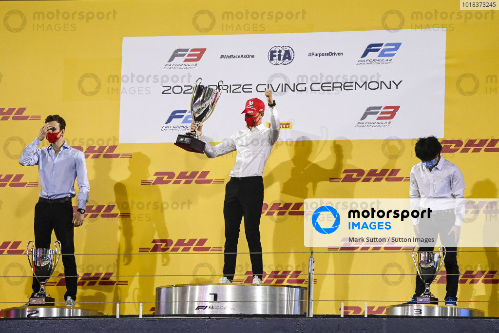 F2 Championship 2nd position Callum Ilott (GBR, UNI-VIRTUOSI) 1st postion Mick Schumacher (DEU, PREMA RACING) and 3rd position Yuki Tsunoda (JPN, CARLIN) celebrate on the podium with the trophy
