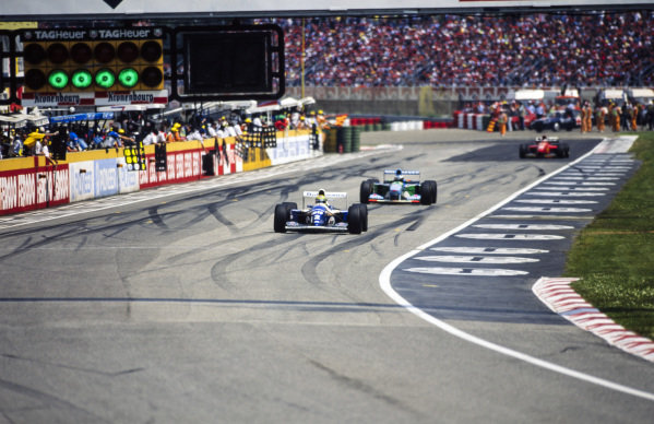 Ayrton Senna, Williams FW16 Renault, leads Michael Schumacher, Benetton B194 Ford.