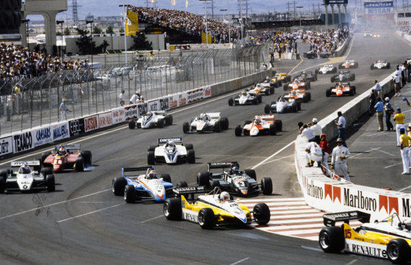 Alain Prost, Renault RE30B, leads René Arnoux, Renault RE30B, Eddie Cheever, Ligier JS19 Matra, Michele Alboreto, Tyrrell 011 Ford, and Keke Rosberg, Williams FW08 Ford, at the start.