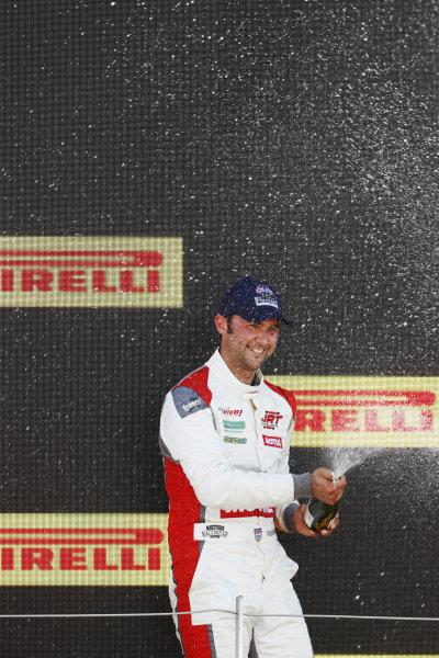 Andrew Jordan, AC Cobra Daytona Coupe, sprays champagne on the podium