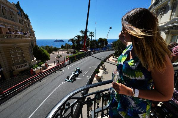 A fan watches Nico Rosberg (GER) Mercedes AMG F1 W05. Formula One World Championship, Rd6, Monaco Grand Prix, Qualifying, Monte-Carlo, Monaco, Saturday 24 May 2014. BEST IMAGE