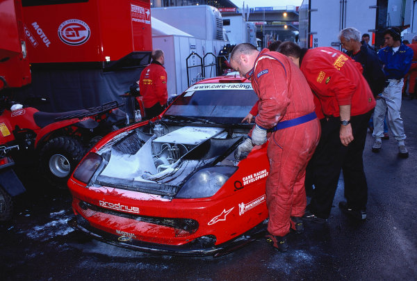 2002 Le Mans 24hr, La Sarthe, France, 15 -16 June 2002. The Prodrive Allstar team look over the burnt out Ferrari 550 Maranello of Menu, Enge and Rydell after it caught fire on the Mulsanne straight. World Copyright: LAT Photographic Ref: 02LM28.