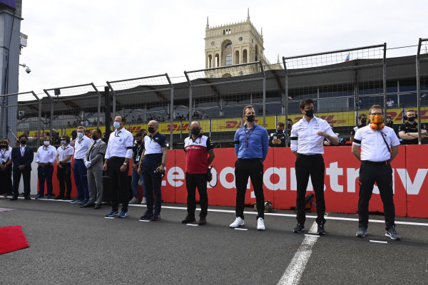 Personnel attend a minute's silence for Mansour Ojjeh and Max Mosley. R-L: Andreas Seidl, Team Principal, McLaren, Toto Wolff, Team Principal and CEO, Mercedes AMG, Frederic Vasseur, Team Principal, Alfa Romeo Racing and Franz Tost, Team Principal, AlphaTauri
