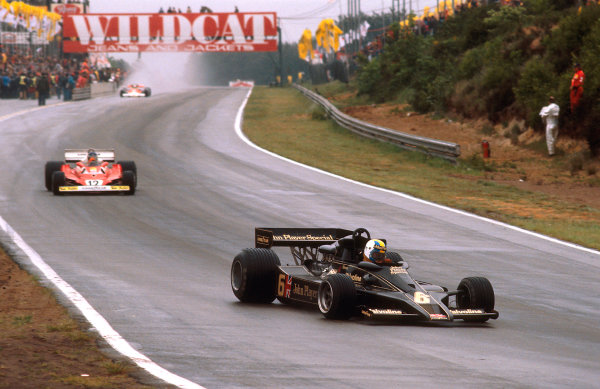1977 Belgian Grand Prix.Zolder, Belgium.3-5 June 1977.Gunnar Nilsson (Lotus 78 Ford) followed by Carlos Reutemann (Ferrari 312T2) takes 1st position for his first and only win.Ref-77 BEL 16.World Copyright - LAT Photographic