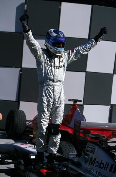 Race winner Mika Hakkinen (FIN) McLaren celebrates and acknowledges the applause of the huge American crowd. United States Grand Prix, Indianapolis, 30 September 2001 BEST IMAGE