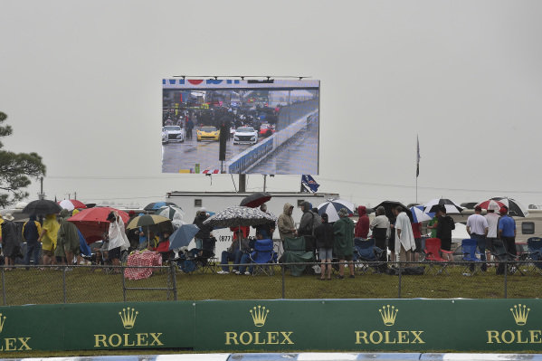Race fans in the rain