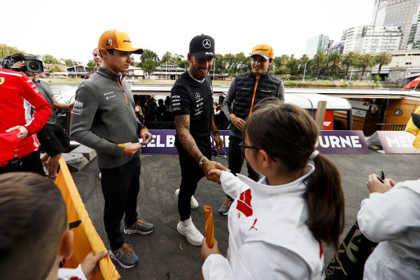 Lando Norris, McLaren, Lewis Hamilton, Mercedes AMG F1 and Carlos Sainz Jr, McLaren with fans at the Federation Square event
