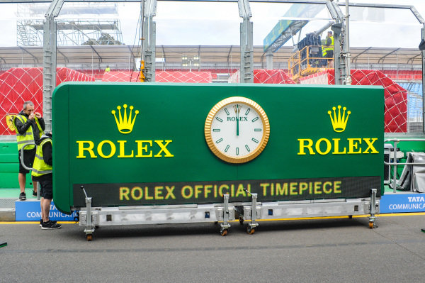 Rolex timepiece being put into place before the Grand Prix