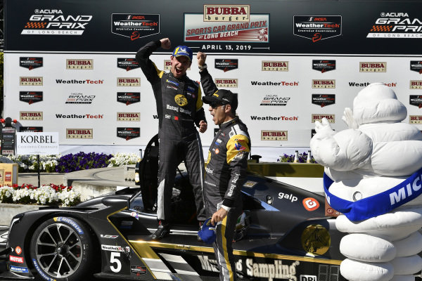 #5 Mustang Sampling Racing Cadillac DPi, DPi: Joao Barbosa, Filipe Albuquerque celebrate the win in victory lane