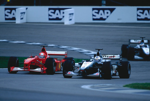 2000 United States Grand Prix. Indianapolis, Indiana, USA.  22-24 September 2000. Michael Schumacher (Ferrari F1-2000) battles with David Coulthard (McLaren MP4/15 Mercedes) for the lead, as he tries to overtake. They finished in 1st and 5th positions respectively. Ref-2K USA 37. World Copyright - LAT Photographic