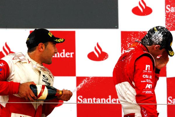 Round 4.Silverstone, England. 11th July 2010. Sunday Race. Daniel Morad, (CAN, Status Grand Prix) celebrates victory on the podium with Alexander Rossi (USA, ART Grand Prix). .Portrait. World Copyright: Charles Coates/GP3 Media Service.  Digital Image _26Y4398