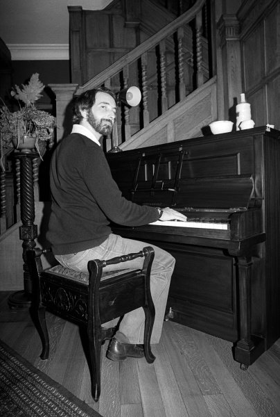 John Watson (GBR) plays the piano at his home.Lifestyle Feature, 1975 Formula One World Championship.