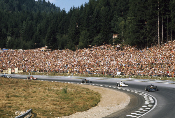 1973 Austrian Grand Prix.  Osterreichring, Zeltweg, Austria. 17-19th October 1973.  Ronnie Peterson, Lotus 72D-Ford Cosworth, 1st position, leads Denny Hulme, McLaren M23 Ford, Emerson Fittipaldi, Lotus 72E Ford, Arturo Merzario, Ferrari 312B3, and Jackie Stewart, Tyrrell 006 Ford.  Ref: 73AUT70. World Copyright: LAT Photographic