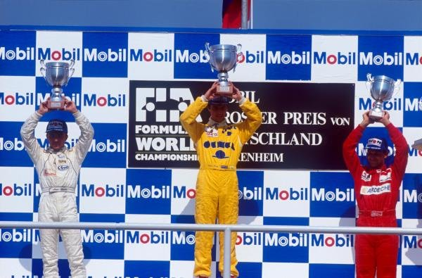 The podium (L to R): Marco Apicella (ITA) second; Eddie Irvine (GBR) winner; Jean-Marc Gounon (FRA) third. 