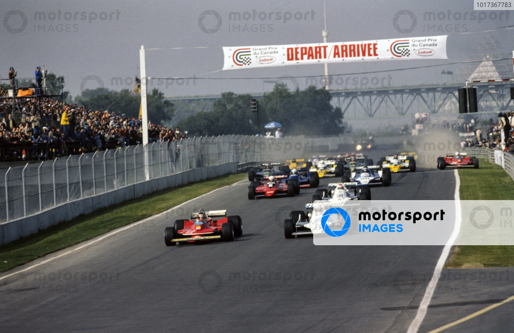 Pole sitter Alan Jones, Williams FW07 Ford leads Gilles Villeneuve, Ferrari 312T4 at the start.