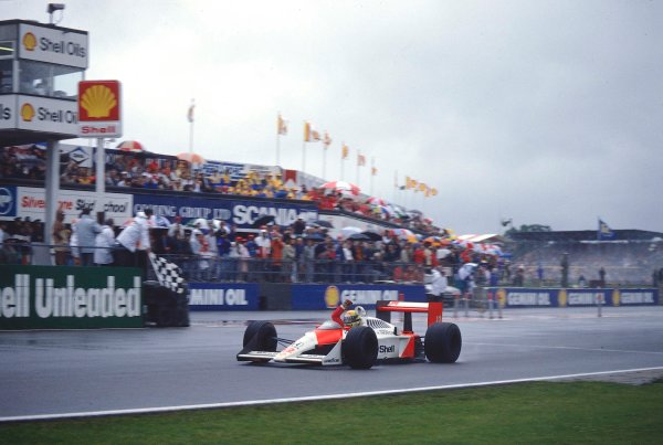 Silverstone, England. 8th -10th July 1988. Ayrton Senna (McLaren MP4/4 Honda), 1st position, takes the chequered flag, action. World Copyright: LAT Photographic. Ref: 88GB41.