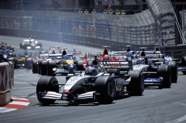 David Coulthard, McLaren MP4-17 Mercedes, leads Juan Pablo Montoya, Williams FW24 BMW, Michael Schumacher, Ferrari F2002, and Ralf Schumacher, Williams FW24 BMW, at the start.