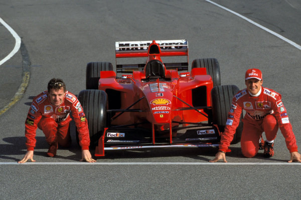 Eddie Irvine, Michael Schumacher and the Ferrari F399 ready for the start of the championship.