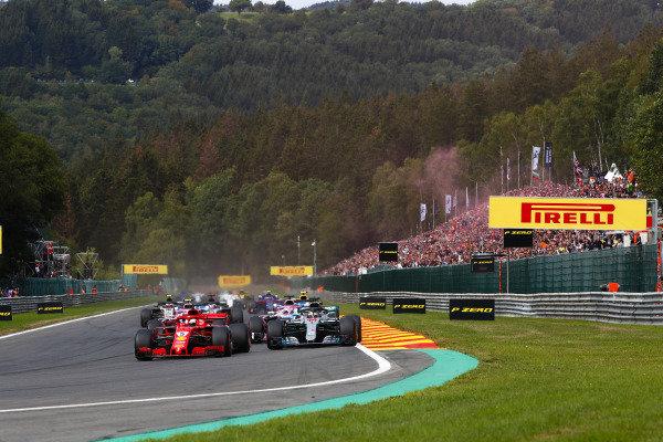 Sebastian Vettel, Ferrari SF71H, leads Lewis Hamilton, Mercedes AMG F1 W09, Sergio Perez, Racing Point Force India VJM11, and Esteban Ocon, Racing Point Force India VJM11, at the start.
