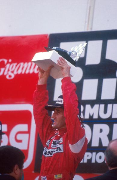 1988 Portuguese Grand Prix.Estoril, Portugal.23-25 September 1988.Alain Prost (McLaren Honda) 1st position on the podium. World Copyright - LAT Photographic
