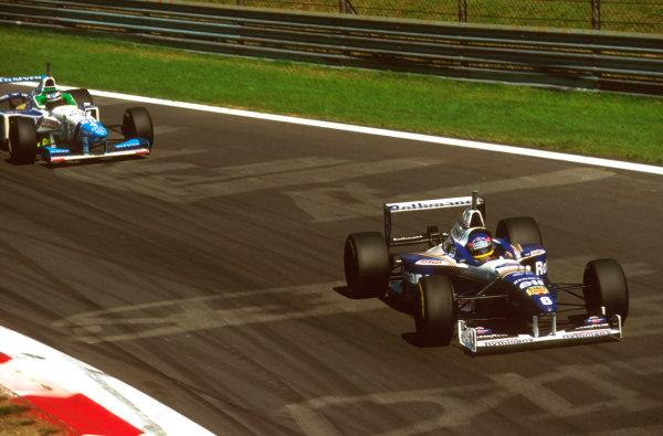 Monza, Italy.6-8 September 1996.Jacques Villeneuve (Williams FW18 Renault) leads Gerhard Berger (Benetton B196 Renault) into Parabolica.Ref-96 ITA 17.World Copyright - LAT Photographic