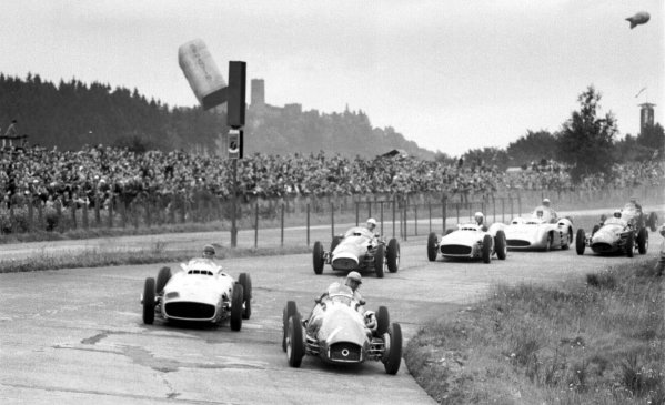 1954 German Grand Prix.Nurburgring, Germany. 30/7-1/8 1954.Jose Froilan Gonzalez (Ferrari 625) leads Juan Manuel Fangio (Mercedes-Benz W196) and Stirling Moss (Maserati 250F) at the start. Fangio finished in 1st position. Ref-70-218 #9.World Copyright - LAT Photographic