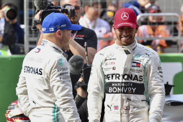 Front row starters Valtteri Bottas, Mercedes AMG F1, and Lewis Hamilton, Mercedes AMG F1, on the grid after Qualifying