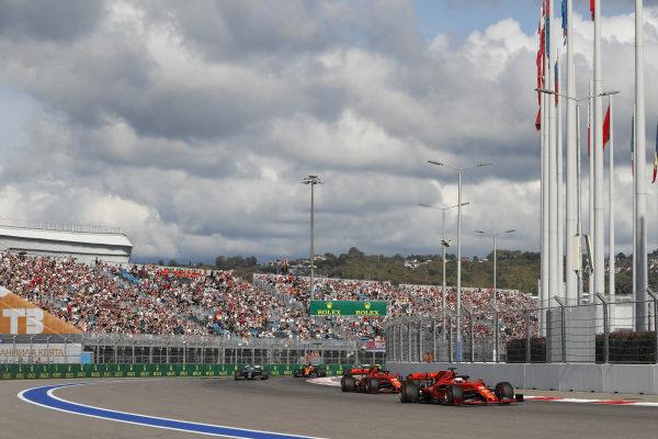 Sebastian Vettel, Ferrari SF90, leads Charles Leclerc, Ferrari SF90 Lewis Hamilton, Mercedes AMG F1 W10, Carlos Sainz Jr., McLaren MCL34 and the rest of the lack at the start