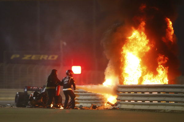 Fire marshals use an extinguisher on a horrific accident of Romain Grosjean, Haas VF-20, on the opening lap of the Bahrain Grand Prix
