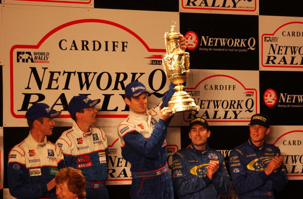 2001 FIA World Rally Championship.Rally of Great Britain. Cardiff, Wales. November 22-25, 2001.Marcus Gronholm holds the winner's trophy on the podium.Photo: Ralph Hardwick/LAT