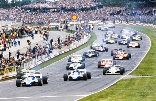 Didier Pironi, Ligier JS11/15 Ford, leads Alan Jones, Williams FW07B Ford, Jacques Laffite, Ligier JS11/15 Ford, Carlos Reutemann, Williams FW07B Ford, Nelson Piquet, Brabham BT49 Ford, and Bruno Giacomelli, Alfa Romeo 179, at the start.