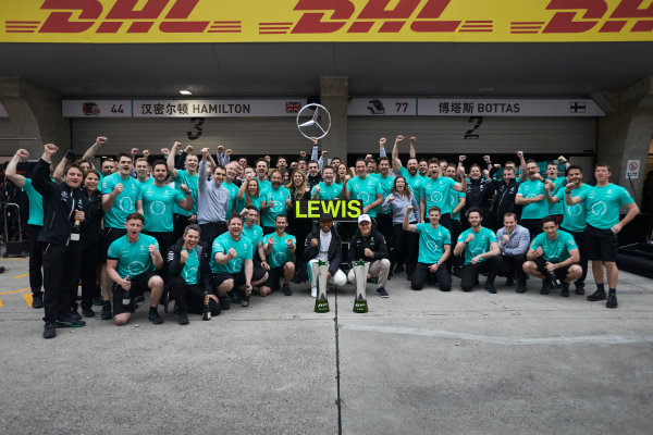 Shanghai International Circuit, Shanghai, China.  Sunday 9 April 2017. Lewis Hamilton, Mercedes AMG, 1st Position, Valtteri Bottas, Mercedes AMG, and the Mercedes team celebrate victory. World Copyright: Steve Etherington/LAT Images ref: Digital Image SNE19077