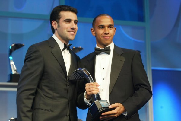 2003 AUTOSPORT AWARDS, The Grosvenor, London. 7th December 2003. Lewis Hamilton, winner of Club Driver award presented by Dario Franchitti. Photo: Peter Spinney/LAT Photographic Ref: Digital Image only